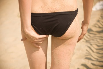Close-up rear view of young woman wearing bikini bottoms
