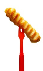 Close-up of French fry on red skewer fork