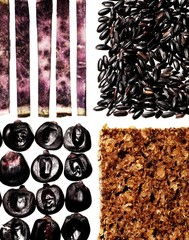 Close-up group of healthy nutritional foods, sliced purple eggplant, grains, granola, and seeds