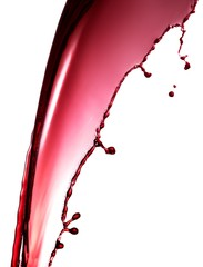 Splash of dripping red wine against white background