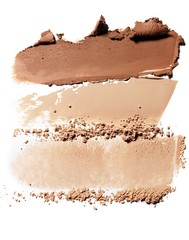Powdered beige bronzer and cosmetics