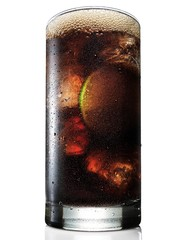 Glass of brown liquid beverage with lime slice