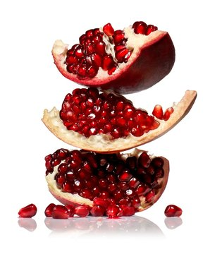 Stacked fresh pomegranate slices with red seeds