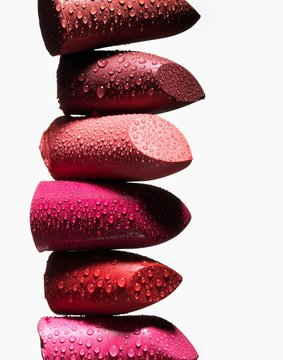 Close up of wet lipstick pieces stacked