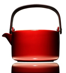 Red tea kettle against white background