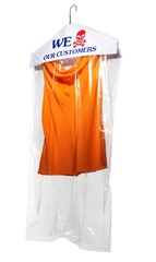 Dry cleaners bag with skull and crossbones over hanger with orange shirt
