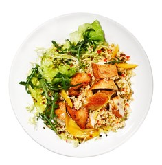 Healthy plate of chicken, quinoa and lettuce against white background