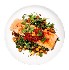 Healthy plate of salmon, quinoa and chickpeas against white background
