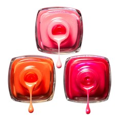 Three nail polish bottles dripping liquid cosmetics