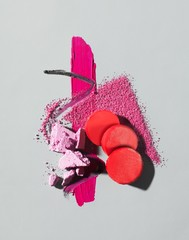 Design of crushed and smeared pink cosmetics and red blush circles