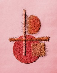 Design of powdered blush cosmetics on pink background