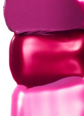 Close-up of pink shades of lipstick and lipgloss