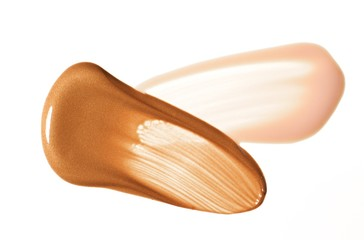 Close-up of smeared shades of beige foundation makeup