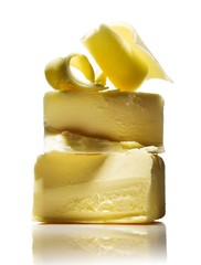 Stack of butter pieces against white background