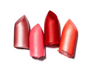 Four red and pink lipstick pieces