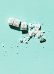 Crushed white pill tablet