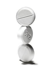 Stack of three white pills