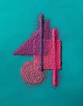 Design of powdered pink cosmetics blue background