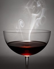 Steaming glass of brown liquid
