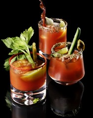 Close up of garnished bloody mary cocktails