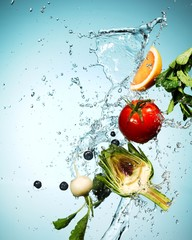 Vegetables and fruit slice splashed in falling water