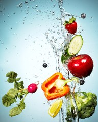 Vegetables and fruits splashed in falling water
