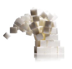 Stack of white sugar cubes against white background