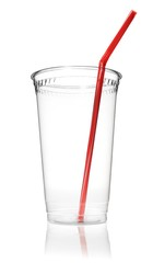 Empty clear plastic cup with drinking straw against white background