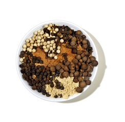 Bowl of powdered spices with seeds and grains