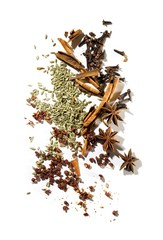 Star anise, cinnamon sticks and spices against white background