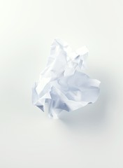Crumpled piece of white paper studio shot
