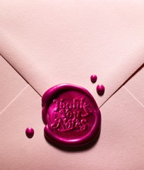 Thank you note in pink envelope
