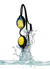 Swimming goggles splashing in water