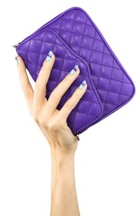 Woman with blue fingernails holding purple clutch purse