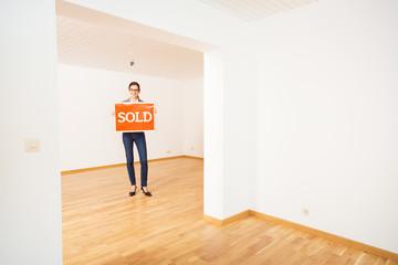 Realtor In Empty Apartment,