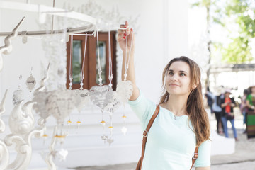 A tourist in a white temple in Thailand