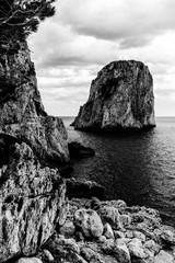 View of Capri (Campania, Italy) typical Faraglioni (sea stacks)