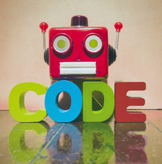 retro red robot head and the word CODE o