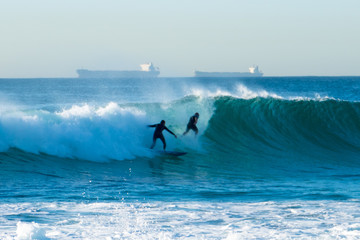 Riding the waves off Newcastle Beach.2.