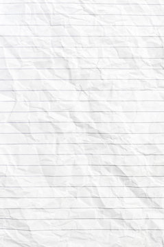 Texture of crumpled notepad sheet. Top view.