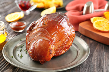 Metal plate with traditional honey baked ham on table