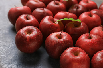 Fresh ripe red apples on table, closeup