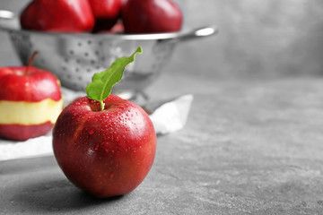 Ripe red apple on table