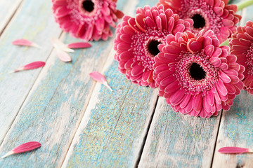 Tuinposter Gerbera Deep color bouquet from beautiful gerbera daisy flowers on vintage wooden background. Greeting card for mother or womans day..