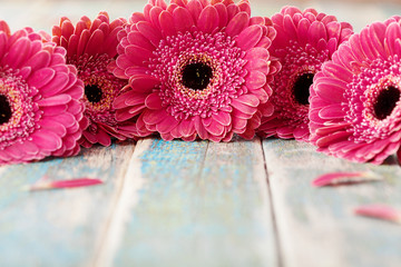Spring gerbera flowers bouquet on rustic wooden background. Birthday, holiday, mother or womans day greeting card..