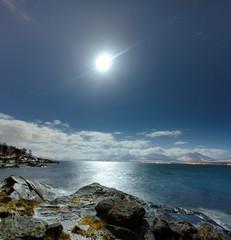 Coast of the Norwegian Sea.Tromso .The full moon. Tromso. Norway.