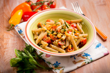 pasta with fresh tomatoes and capsicum,selective focus