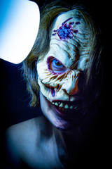 Zombie woman with dead living mask