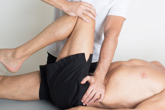 Massage therapist giving a knee treatment