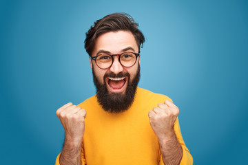Excited man with fists up
